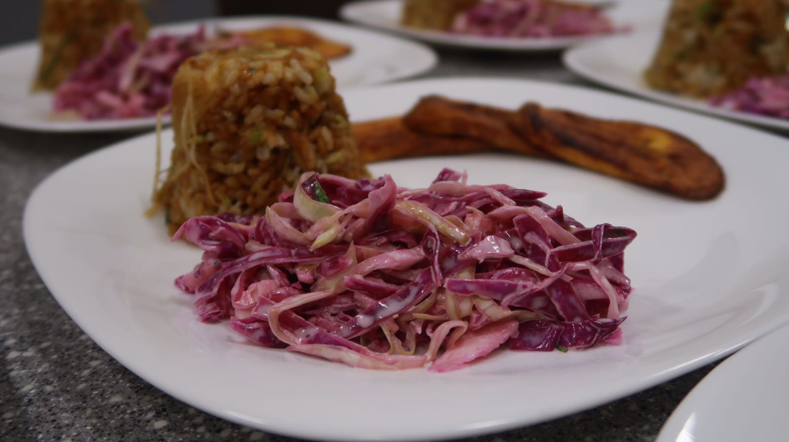 Coleslaw, flavoured rice and plantain